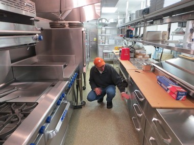 Chris Wood, owner of Woody's Ocean Grille in Sea Bright, tours his newly restored kitchen, which was destroyed by Hurricane Sandy.
