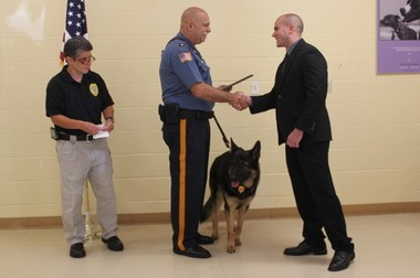 Former Highlands police Officer Michael Carlino, who now works as a New Providence police officer, receives an award for saving a dog's life.