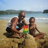 During happier times, Kenroy Smith plays in the sand with daughter AbbieGail. (Courtesy, Kenroy Smith)