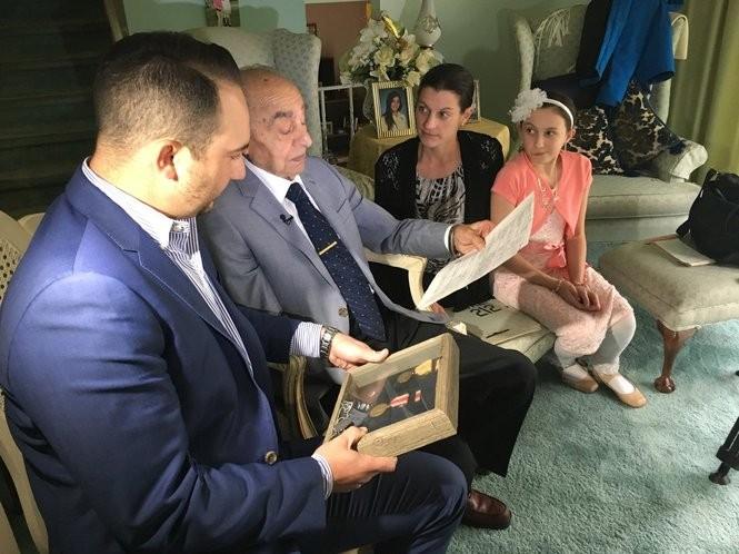 Vito Perillo, center, sits in the living room with his grandson, Mike Perillo-Gentile, left, his granddaughter, Melissa Balsamello, and his great-granddaughter. (Alex Napoliello   NJ Advance Media for NJ.com)