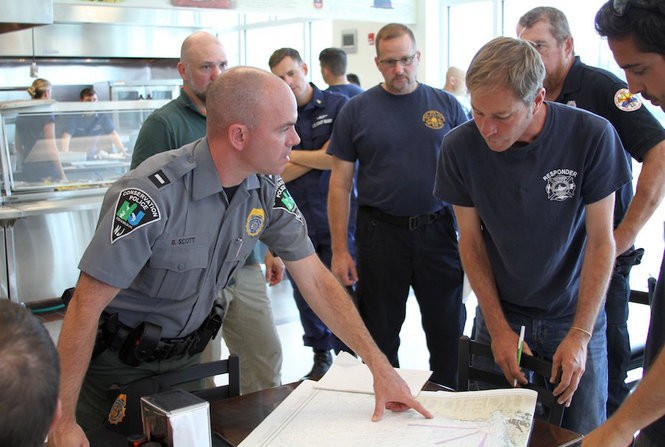NOAA and officials with state and local jurisdictions gather Wednesday to plan a course of action for finding and disentangling the whale. (Photo courtesy of NOAA Fisheries Public Affairs)