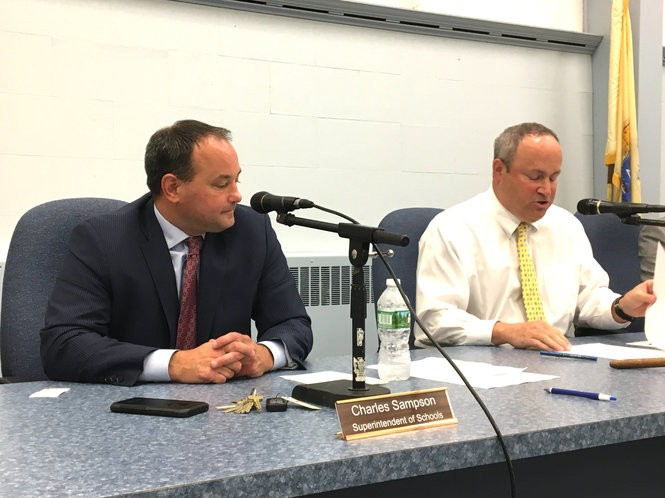 Superintendent Charles Sampson, left, and Board of Education President Michael Messenger at a meeting of the Freehold Regional High School District on Wednesday night.