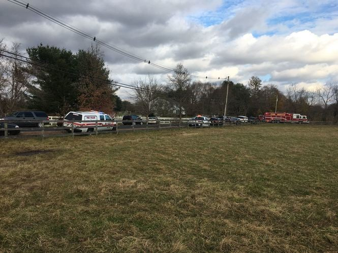 Emergency vehicles block the road lead to the fatal house fire in Colts Neck on Tuesday afternoon.