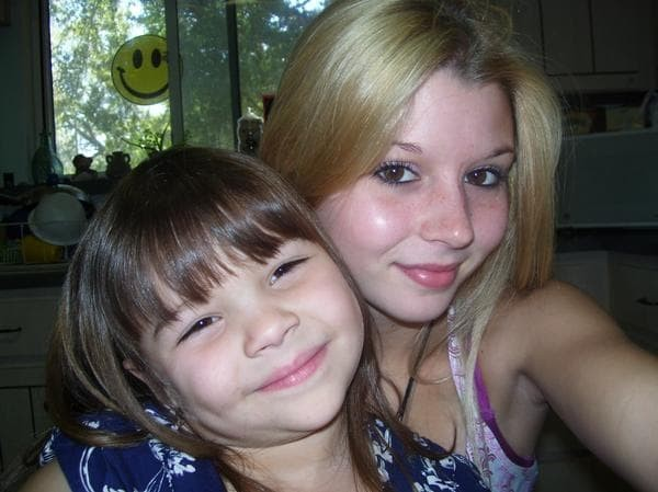 Madison Wells, left, and her former babysitter Brittany Davis in 2006. (Handout photo)