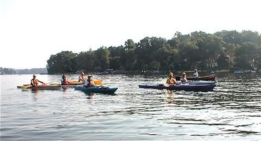 Knee Deep Club Water Scouts paddle through Landing Channel in 2010 to make sure all water chestnuts have been removed.