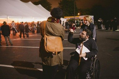 Charlotte Adventure gets a fistbump from a fellow steampunker at Steampunk City in 2012.