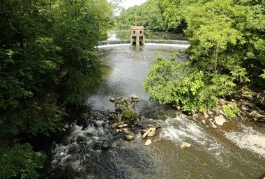 Speedwell Lake flows over a dam in the Whippany River.