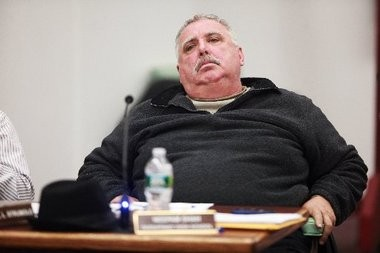Michael Strumolo during a Parsippany Board of Education meeting in 2011. Strumolo, who stopped servicing the district's buses in 2009, no longer holds public office. He was ordered to pay damages to the board's former transportation coordinator.