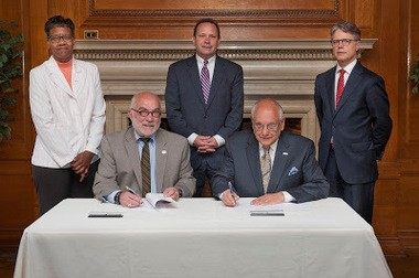 Officials from County College of Morris and Fairleigh Dickinson University sign their agreement for the CCM-FDU Scholars Program. From left, they are Bette Simmons,CCM vice president of student development; Edward Yaw, CCM president; Peter Woolley, provost of FDU's Florham Park campus; Sheldon Drucker, FDU president and Dwight Smith, CCM vice president of academic affairs. (W. Scott Giglio)