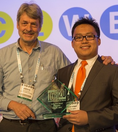 Zachary Espiritu receives his award from CE Week competition judge Warren Buckleitner, CEO, Children's Technology Review.