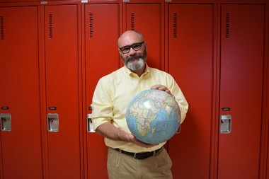 Social studies teacher Matthew Higgins hopes to collect plenty of globes for students to use in the classroom.