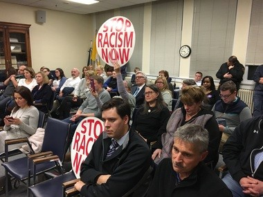 Spectators packed a Mendham Township Committee meeting on Monday night