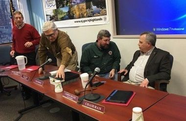Jim Rilee, on right, talking with Kurt Alstede, the Highlands Council's vice chair, at a meeting in Feb. 2017. Also shown are council members Carl Richko and Michael Sebetich.