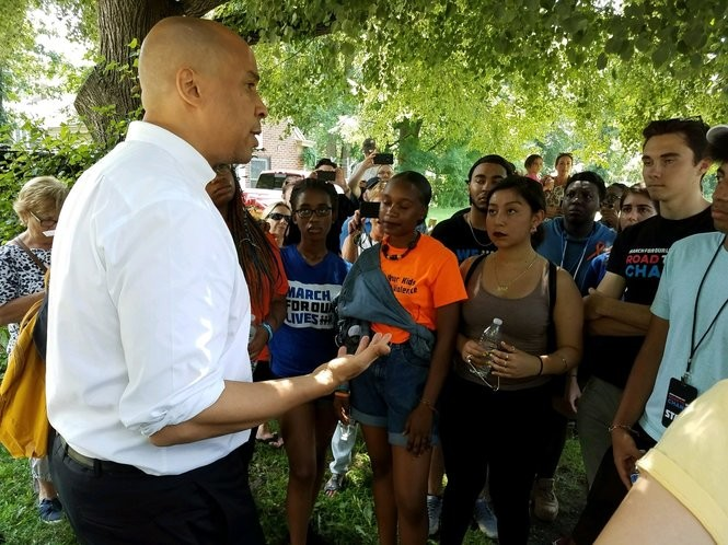 U.S. Sen. Cory Booker, on left, speaks with 'March For Our Lives' participants in Morristown, Aug. 9, 2018. Seen on right is David Hogg, survivor of the Parkland, Fla., high school shooting in February. (Photo by Rob Jennings / NJ Advance Media for NJ.com)