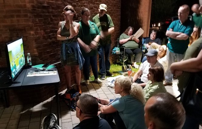 Rockaway Township residents watching the council meeting, at 12:30 a.m., on a screen set up outside the municipal building because there wasn't enough room inside, Sept. 15, 2018 (Rob Jennings / NJ Advance Media for NJ.com)