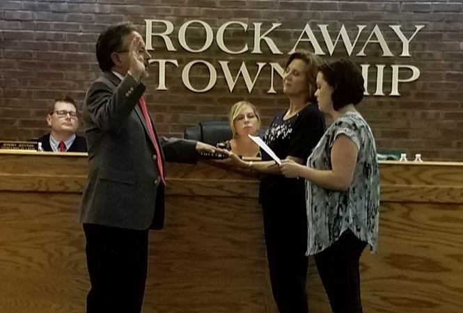 Rockaway Township Interim Mayor Paul Minenna (left) is sworn in at the Sept. 14 township council meeting.