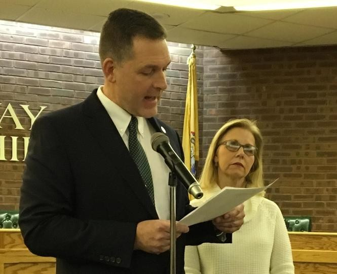 Rockaway Township Mayor Michael Puzio speaks after taking the oath of office, with Cathy Dachisen, widow of late Mayor Michael Dachisen, standing nearby, Nov. 20, 2018.