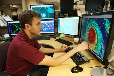 Hurricane specialist Eric Blake uses a computer at the National Hurricane Center to track the path of Hurricane Joaquin as it passes over parts of the Bahamas and begins moving north up the Atlantic coast. (Joe Raedle | Getty Images)
