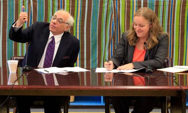 Newark Teachers Union President Joseph Del Grosso, left, and Newark schools Superintendent Cami Anderson sign a tentative agreement on a new teachers' contract in October 2012.