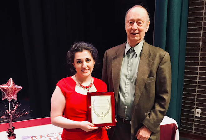 Victoria Gatopoulos, a high school senior from East Rutherford, receives the Garibaldi Award for promoting Italian culture from Silvio Laccetti, a retired college professor who founded the honor. (Photo courtesy of Silvio Laccetti)