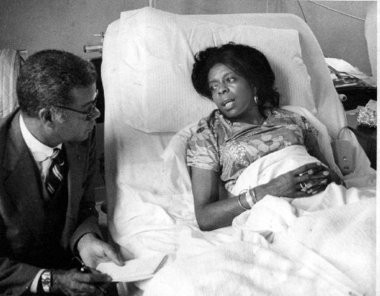 Newark activist Carolyn Kelley being interviewed by the late Chuck Stone after her beating a the hands of Hurricane Carter.