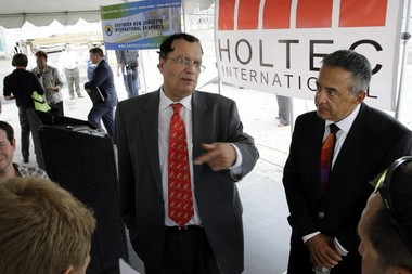 Kris Singh, center, the founder, president and CEO of Holtec International answers a question Monday, July 14, 2014, in Camden, N.J. The company that makes components for power plants said Monday that it eventually expects to bring 3,000 jobs to the facility it plans to build in Camden, one of the nationâs poorest cities. Holtec, a privately held firm that plans to make storage containers for spent nuclear fuel and modular nuclear reactors designed to be terrorism-proof in the Camden plant, detailed its plans on Monday. It says it will not have any nuclear fuel at facility in Camden that was once home to a New York Shipbuilding Corp. yard that at time employed 30,000 people.(AP Photo/Mel Evans)