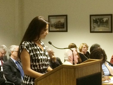 Jersey City resident April Kruzas cross-examines the Hudson County Board of Freeholders about Mickey McCabe, deputy coordinator of the county Office of Emergency Management, and the relationship the county has with his firm, the Bayonne-based McCabe Ambulance, at Thursday's county meeting.