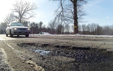 Potholes like this one can damage cars as they did on the N.J. Turnpike in Ridgefield Park yesterday.