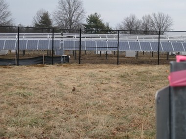 A solar array on what was once a green field at Mercer County College. Such arrays must be fenced off with chain link because of the hazard from high voltage. The Sierra Club supported the clearing of 30 acres of farms and forests for this scheme.