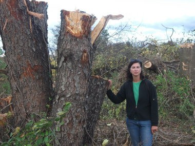 Teresa Lourenco with trees cut down for the Solar array at Mercer County College; this is one of many such projects that were supported by the Sierra Club.
