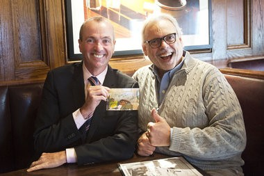 Philip Murphy, recently announced candidate for governor, poses for a photo with Political Insider Augie Torres, on Thursday, Jan. 22, 2015, at the Coach House Diner in North Bergen. Muphy is holding a photo of the family hamsters, Tiberius and Humphrey.