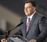 "In this Feb. 26, 2014, file photo, USA Gymnastics president Steve Penny speaks during a news conference in Arlington, Texas. An investigation into USA Gymnastics published Aug. 4, 2016, determined the organization collected complaints of improper conduct by over 50 coaches between 1996 and 2006 and regularly declined to forward them on to the authorities unless expressly asked to do so, opening the door for further abuse in some cases. Penny said during a 2015 deposition, ""to the best of my knowledge, there's no duty to report if you are -- if you are a third party to some allegation."" (AP file photo/The Fort Worth Star-Telegram, Ron Jenkins)"