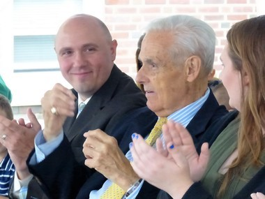 Former Union City Mayor Arthur Wichert, center, was honored yesterday as a block of 16th Street, where his home is located, was named after him. His son, Bill, left, applauds at the West Street intersection ceremony on Friday, June 14, 2017.