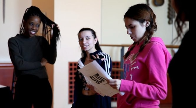 """From left, Newark high school students Al-nisa Petty, Claudia Goncalves and Kristine Morales rehearse lines from """"SLUT: The Play,"""" which will be performed at NJPAC on April 27. (Photo:Yasmeen Fahmy)"""