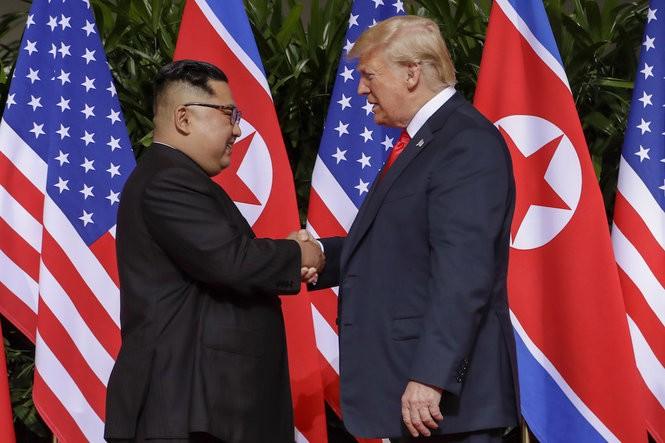 President Trump shakes hands with North Korea leader Kim Jong Un at the Capella resort on Sentosa Island Tuesday, June 12, 2018 in Singapore. (Evan Vucci | Associated Press)