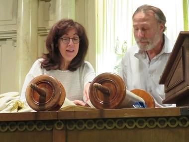 Rabbi Leana Moritt and Temple Beth-El board member Irwin Rosen discuss the Torah.