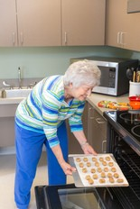 Doris Carney of Sayreville enjoys baking in the neighborhood kitchen at Venetian Care & Rehabilitation Center in South Amboy. Sweetwater Construction Corp. worked with the architect and Venetian owner Windsor Healthcare Communities to build the recently opened Venetian, embracing the concept of 'household living.'