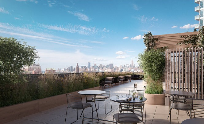 With the Manhattan skyline as the backdrop, residents of 75 Park Lane and Shore House in Jersey City can enjoy an expansive communal rooftop garden with a variety of seating options.