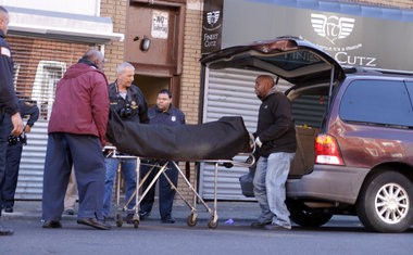 A body is removed from an apartment on Rosa Parks Boulevard in Paterson, Oct. 5, 2014. (Myles Ma | NJ Advance Media for NJ.com)