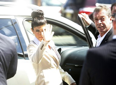 """""""Real Housewives of New Jersey"""" star Teresa Giudice waves as she leaves the Federal Courthouse in Newark after being arraigned on two additional counts of fraud in August 2013. (Ed Murray/The Star-Ledger)"""