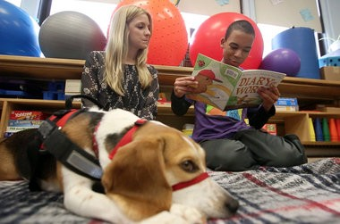 Robert reads with teacher Lara Ferment as service dog Cleo, a one-and-a-half year old Beagle, sits with them at the Calais School. 4/2/15 Whippany, NJ (John Munson | NJ Advance Media for NJ.com)