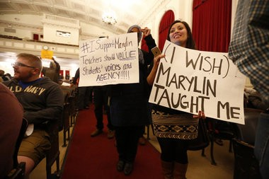 Stephanie Rivera, of New Brunswick, right, holds a sign in support of Orange teacher Marylin Zuniga. She was among many who voiced their opinion to the Orange school board during a meeting at Orange Preparatory Academy. Orange, NJ 4/14/15 (Saed Hindash | NJ Advance Media for NJ.com)