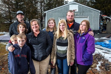 Matt and Jen Toole with 7 of their 8 children (l to r) Tate, 7; and Trent, 9; Tanner, 12; Chloe, 15; Claudia, 17; Tyler, 25 and Claire, 21 gather on the lot in Manasquan where their family home stood before it was destroyed by Hurricane Sandy more than 2 years ago.