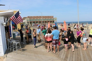A line stretches from Eddie Confetti's on the Asbury Park boardwalk on Monday, May 25. (Rob Spahr | NJ Advance Media for NJ.com)