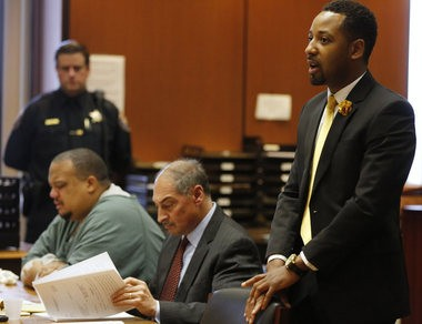 Marcus Jeter, right, who was falsely arrest by former Bloomfield Police Officer Orlando Trinidad, seated left, addresses the court before Trinidad was sentenced to 5 years in state prison. On Nov. 5 a jury found Trinidad and co-defendant officer Sean Courter guilty of official misconduct and related charges for submitting false police reports about a 2012 arrest of Marcus Jeter. Courter will be sentenced at a later date. Newark, NJ 1/22/16 (Robert Sciarrino | NJ Advance Media for NJ.com)