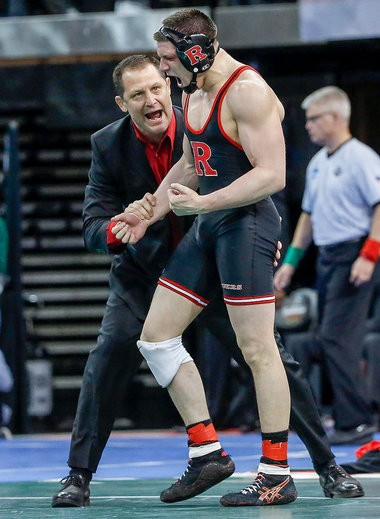 Rutgers head coach Scott Goodale congratulates Anthony Perrotti (Rutgers/West Essex) after he beat Connor Brennan (Rider/Brick Twp.) to earn All-America status.