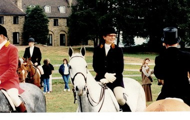 Jacqueline Kennedy Onassis at the Essex Fox Hounds Thanksgiving meet in the early 1990s. Behind her and to the left is her son, John Kennedy