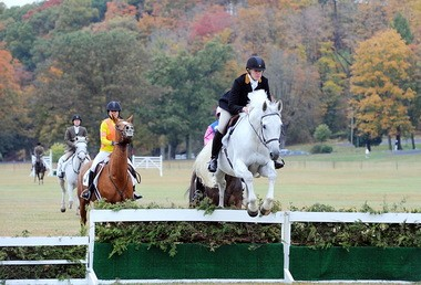 """Karen Murphy leads the field in the Masters' Chase, in which riders stay behind the leader until they're turned loose with a """"tally ho"""" and are free to race for the finish line."""