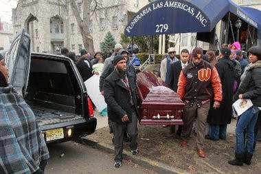 "Pallbearers carry the casket out to an awaiting hearse after the viewing for 14 year old Abdul Frazier a.k.a ""Scooter"" at Funeraria Las Americas on Roseville Av. Frazier was the third teenager shot in the South Ward on Christmas night, and passed away in the hospital last Friday"