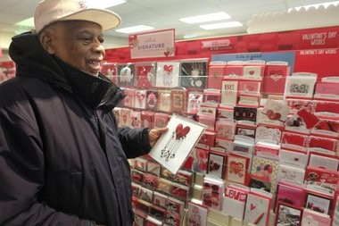 87-year-old Wallace Lee picks out a Valentines Day card for his 104-year-old wife at a Chatham card store.